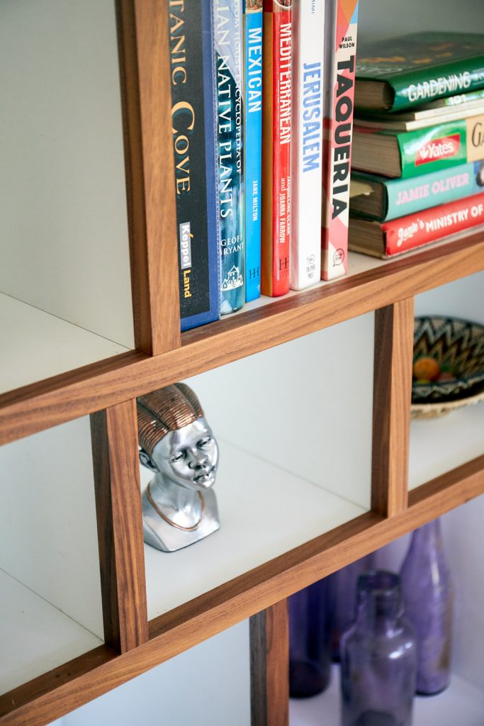Detail of timber trim with melamine shelf