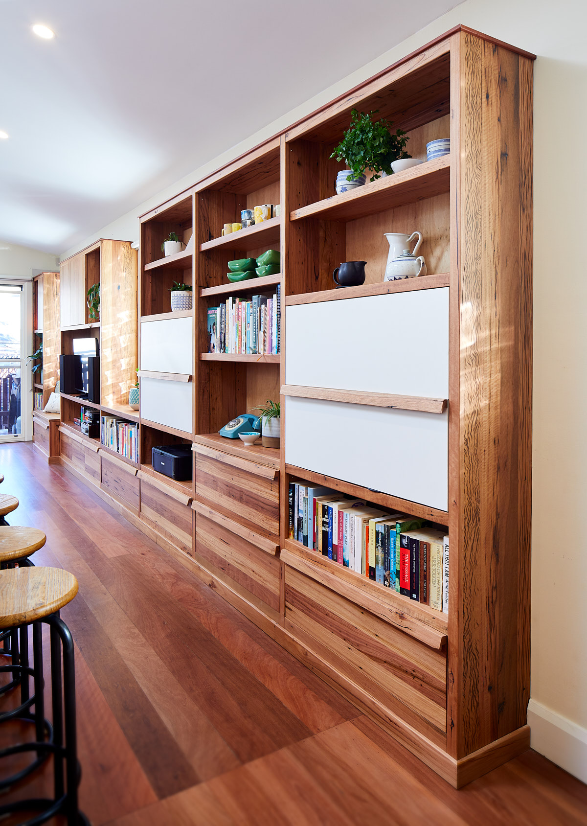 Large timber bookcase with desk closed